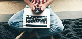 bigstock-Hipster-student-typing-text-me-96098693-353x167